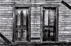 The door on the left, or... (Scott Sanford) Tags: 6d abandoned bigthicket canon ef2470f28l eos summer texas topazlabs vintage weathered antique beautiful historic blackandwhite bw monochrome wood decay old naturallight outdoor lines details mood