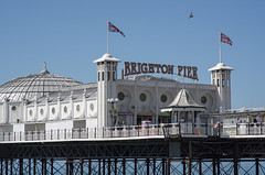 Brighton Pier (grahambrown1965) Tags: pentaxk5iis k5iis pentax 70mm limited limitedlens pentaxlimitedlens hd hdlens brighton sussex eastsussex pier brightonpier palacepier pigeon flag flags unionjack pigeons bird birds flight flying