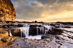 Kauai (Glenn Guinita) Tags: coast coastline coastal sunrise sunset water ocean longexposure kauai hawaii clouds sky waves sea seascape
