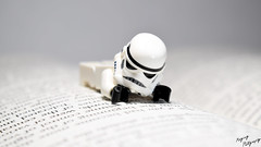 Reading (RagingPhotography) Tags: lego star wars galactic empire imperial stormtrooper reading books knowledge library words text pages page paper white background backdrop laying cute toy toys figures plastic figure minifigure minifig ragingphotography d3300