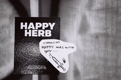 Happy Herb (jcbkk1956) Tags: wall manualfocus 45mmf28 carlzeiss hypothermic needle happy herb pan100 ilford 167mt contax 35mm film blackandwhite mono streetfurniture street thailand bangkok graffiti sticker worldtrekker