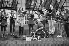 You Are Passing Through (Ian Sane) Tags: ian sane images youarepassingthrough choir singing street performers wheelchair man black white candid photography pioneer courthouse square downtown portland oregon canon eos 5d mark ii two camera ef70200mm f28l is usm lens