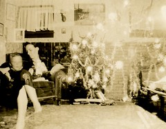The Ghosts of Christmas Presents (Alan Mays) Tags: ephemera photographs photos foundphotos snapshots doubleexposures portraits christmas xmas december25 holidays women children boys legs christmastrees trees ornaments decorations lights presents gifts wrapped interiors rooms chairs ghosts ghostly mysterious strange unusual semitransparent flawed humor humorous funny amusing old vintage