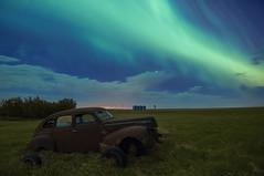 Stranded at the drive-in (Len Langevin) Tags: aurora borealis northernlights night sky longexposure abandoned old rusty car rustbucket alberta canada nikon d300s tokina 1116