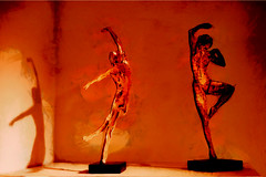 Dancing the Night Away (Steve Taylor (Photography)) Tags: dance dancing dancer art sculpture man lady woman uk england shadow shiny hallplace bexley brown orange