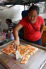 Tofu callejero (pacientt) Tags: vendedora ambulante tofú pimentón cebollino