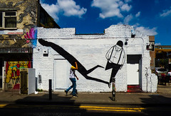 Art Theft (Steve Taylor (Photography)) Tags: ska yellowlines createordie owl alex senna art graffiti mural streetart building shop blackandwhite man uk england london perspective shadow surreal tall sunny sunshine clouds