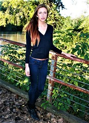 Autumn Beauty (PhotoAmateur1) Tags: black boots shoes blue jeans denim long legs feet shirt top tank chest cleavage hair neck throat arms hands fingers brunette brown pink lips face head green grass bridge autumn fall water river trees outside outdoors photo session shoot beautiful beauty model woman lovely pretty gorgeous attractive female femme feminine