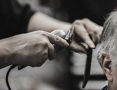 The friendly barber (Jan.Timmons) Tags: select barber barbershop customer buzzsaw blackcomb hands customersear smallshop experiments desaturated jantimmons pacificnorthwest