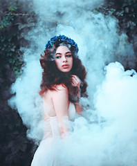 Blue Roses (Kelly McCarthy Photography) Tags: woman model beautiful beauty fashion style glamour fantasy fairytale smoke catchycolorsblue mybrowneyedgirl mist outdoors ivy brunette makeup curlyhair curls photography photoshoot floral flowers blue fairy dark magic maiden cold fog portrait portraiture dress