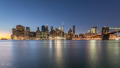 Blue hour over New York skyline (mathieuo1) Tags: nyc skyline skycrapper newyorkcity usa city town urban explore discover brooklyn bridge hdr dynamic nikon panorama landscape cityscape view iconic awesome water eastriver one wtc night le longexposure manual wide wideangle winter light illumination christmas reflexion tower building architecture mathieuo dlsr