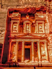 Rose-Red Treasury in Petra, Jordan (WorldExplorations) Tags: architecture building desert middleeast jordan urn castorandpollux unesco culturalsite worldheritage wondersoftheworld new7wonders new7wondersoftheworld archeological archiological site civilization nabataean history historic ancient mythology vault statue monument columns rosered sandstone rock stone carving tomb treasury alkhazneh petra albatrā