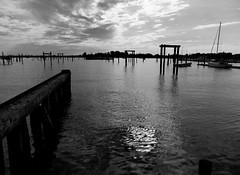 Sunset (KaDeWeGirl) Tags: newyorkcity bronx cityisland marina pilings sunset bw clouds explore