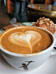Hearty latte at Storyville Coffee (Ruth and Dave) Tags: storyvillecoffee pikeplace seattle coffeeshop coffeehouse cafe drink beverage heart latteart logo croissant almondcroissant treat pastry