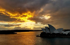 Fire in the sky (Explore) (missgeok) Tags: sunrise sydney circularquay australia fireinthesky fiery dramatic mood morning mobilephone samsung cloudy golden sea water sydneyoperahouse clouds whatasunrise beautiful landscape explore