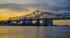 Double Vision (fuzzy_dunlop_nola) Tags: mirrorless river lights neworleans landscape waterscape city light fuji fujifilm fujixt2 color colors colorful cloud cloudy clouds mississippiriver sunset sunlight vivid evening dusk riverfront view longexposure cityscape crescentcity downtown fujifilmxt2 waterfront 35mm fujinon nola southlouisiana fujix xf35mmf14r astia crescentcityconnection neworleanslouisiana bwfilter ndfilter reflection waterway neutraldensityfilter