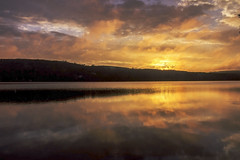 Le Soleil Se Couche (SNAPShots by PJW *Join LNP*) Tags: sunset clouds cloudscapes light sun sunlight night water lake reflections sky landscapes detail dof depthoffield orange yellow outside nature