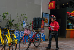 burger delivery man (Chilanga Cement) Tags: fuji fujix100f x100t xseries x100s burger delivery man bicycle china guangzhou m mcdonalds meat food travel travelphotography spokes wheel wheels red yellow goldenarches