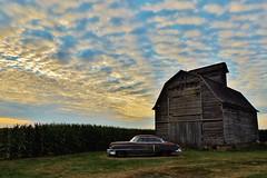 sunset at the ranch... (BillsExplorations) Tags: cadillacranch cadillac abandonedcar car ranch sunset sky clouds illinois oldcar rust farm corn field crib old vintage