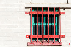 Red & Green Window (BigRedTroll) Tags: architecture bars brick building decay decayed decaying england faded green grille material minimal northampton northamptonshire northants pattern peeling prison red redandgreen structuralelement structure texture threecounties wall white window