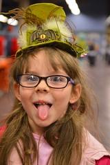 Her serious face (radargeek) Tags: umc undergroundmonstercarnival 2017 statefairgrounds tongue hat glasses kid child