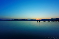 Just before Sunrise (Johan Konz) Tags: bluehour dusk sunrise lake lago lagotrasimeno sarcangelo umbria italy blue sky pier landscape outdoor water waterscape serene longexposure hills endorheiclake nikon d90