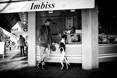 Please, a sausage for me and a tofuburger for my master (AlphaAndi) Tags: mono monochrome urban city trier tiefenschärfe leute people personen portrait face dog hund sony