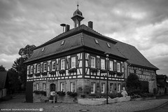 The historic townhall of Dahenfeld. (andreasheinrich) Tags: architecture village townhall afternoon june blackandwhite blackandwhitephotos germany badenwürttemberg neckarsulm dahenfeld rainy overcast windy deutschland architektur dorf rathaus nachmittag juni schwarzweis regnerisch bewölkt nikond7000