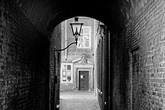 Citylight (Alfred Grupstra) Tags: architecture street blackandwhite urbanscene old alley buildingexterior narrow city door history builtstructure europe house town nopeople outdoors wallbuildingfeature cultures light dordrecht nederland nl