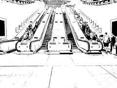 North Greenwich Escalators (Steve Taylor (Photography)) Tags: northgreenwich escalator architecture art digital graphic blackandwhite monotone monochrome people uk england london lines contrast
