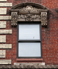 Green Beast: A window facing Morton Street, 272 Bleecker Street, Greenwich Village, New York (Spencer Means) Tags: greenman greenbeast stone carving carved window frame decoration morton bleecker 272 street greenwichvillage neighborhood newyork ny nyc city apartment architecture