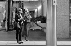 Up And Down (burnt dirt) Tags: houston texas downtown city town mainstreet street sidewalk corner crosswalk streetphotography fujifilm xt1 bw blackandwhite girl man woman people person couple pair group crowd walking talking standing looking boots heels stilettos sandals model photographer camera lens dress skirt shorts glasses sunglasses purse bag phone cellphone pose longhair shorthair ponytail kneehigh blonde brunette headphones cap hat asian friends bike bicycle prom lovers