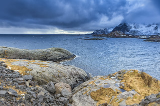Travel Concept and Ideas. Lofoten Islands Scenery against Snowy Mountains. During Spring Time