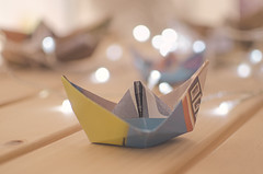 Sailing in a sea of lights (Bego Alcántara) Tags: activity boat business concepts different direction first fleet fragile freedom game handmade horizontal journey lake leadership leisure nature nautical navigate newspaper origami outdoors paper paperboat sailing season ship shore simple simplicity speed spring stream success toy transportation travel trip voyage