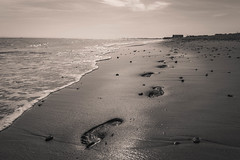 Here Today, Gone Tomorrow (NVOXVII) Tags: footprints sand beach coast monotone sepia arty waves haylingisland summer canon eos m10 leadinglines lowdown perspective creative mellow chill