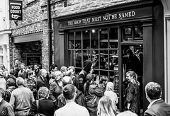 """Queueing at """"The Shop that must not be Named"""" (steve.gombocz) Tags: urbanstreet blacknwhite greyscale streetscene blackwhite bwphotos bwstreetscenes bw bwstreet flickrbw bwflickr blackwhitephotos blackwhitephotography flickrstreet blackwhitestreet bwstreetphotography streetlife street blackandwhite streetphotographs bwphotographs bwphotography streetbw photosinblackandwhite bwpictures flickraddicts blackandwhitephotographs purestreet out outandabout streetpictures streetphotos flickr exploreflickr shop york yorkbw yorkscenes yorkblackandwhite exploreyork flickryork zwartwit neroebianco sortoghvid mustavalkoinen svarthvitt svartoghvitt svartochvitt pretoebranco noiretblanc schwarzundweiss negroyblanco noirblanc schwarzweiss negroblanco pretobranco nerobianco olympus olympususers olympusamateurs olympuseurope olympuszuikodigitalclub olympusm25mmf18 olympusem5mark2 olympusomd olympuszuikodigital"""
