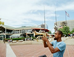 Baltimore Portrait (Georgie_grrl) Tags: baltimore baltimoreinvasion harbourfront musician trumpetplayer horn portrait music performer pentaxk1000 maryland rikenon12828mm