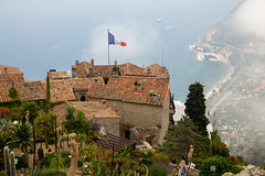 View from le jardin exotique, Èze, southern France (vambo25) Tags: france southoffrance cotedazur 2017 lejardinexotique exoticgarden èze eze flag cloud mediterranean rooftops terracotta medieval village cactus