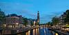Amsterdam. (alamsterdam) Tags: amsterdam canal prinsengracht longexposure reflections westerkerk westertoren bridge cars bikes evening boats