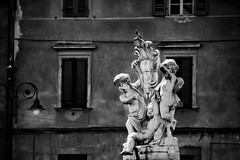 Angels Statue in Pisa - Italy (EXPLORED) (andrebatz) Tags: angels pisa italy tuscany statue marble sculpture piazza square leaning tower black white bw fineart art city house contrast nikon d7100 sigma lens