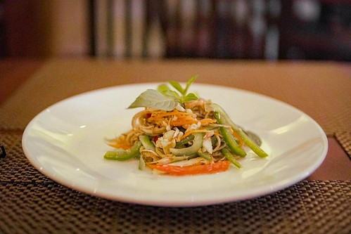 A simple banana bud salad, spooned over cold glass noodles. The banana bud itself is not particularly flavorful; the dish gets the bulk of its taste from the lime juice and tamarind paste, which together cast a very sour tint. Heat and sour are the duelin