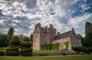 Crathes castle & its magnificent topiary in the May sunshine, Aberdeenshire, Scotland, UK