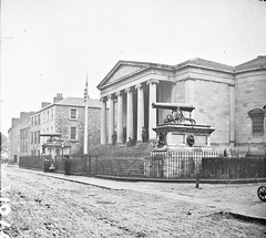 """Large public building, railings, steps, 6 columns in portico, 2 guns on plinths, one plinth inscribed India"" is Tralee Courthouse (National Library of Ireland on The Commons) Tags: thestereopairsphotographcollection lawrencecollection stereographicnegatives jamessimonton frederickhollandmares johnfortunelawrence williammervynlawrence nationallibraryofireland building cannons plinths steps columns collonade tralee countykerry court courthouse cannon ashestreet crimea india plaque crimeanwar indianrebellion locationidentified"