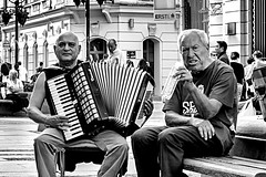 The Musician and Fellow Story-teller / Belgrade in Black&White (D. Cassarino Photography) Tags: lightroom streetphotography streetshot streetartist streetportrait 50mmprimelens 50mmportrait yongnuo50mmf18 canon400d portrait blackandwhite people monochrome accordion musician
