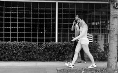Athletic (burnt dirt) Tags: houston texas downtown city town mainstreet street sidewalk corner crosswalk streetphotography fujifilm xt1 bw blackandwhite girl man woman people person couple pair group crowd walking talking standing looking boots heels stilettos sandals model photographer camera lens dress skirt shorts glasses sunglasses purse bag phone cellphone pose longhair shorthair ponytail kneehigh blonde brunette headphones cap hat asian friends bike bicycle prom lovers