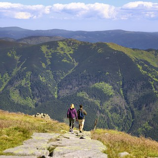Easy hiking over a mountain ridge leading up the highest peak of Low Tatras