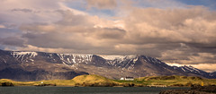 View from Reykjavik Harbour (williamwalton001) Tags: mountains harbour hillside house colourimage clouds coastal landscapephoto iceland buildings sun|sky|cloud outdoors water weather greenscene trolled legacy trollieexcellence heavenlycaptures netart ii