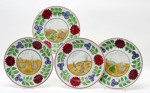 19th c. Rabbitware Staffordshire Plates, Lot of Five ($700.00): Black rabbits on yellow background around rim. Hand painted stick spatter floral center.