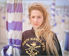 Untitled (Steve Lundqvist) Tags: sweatshirt felpa girl seaside sea mare beach spiaggia nikon 105mm hair beauty women italy adriatic adriatico face young teen teenager shorts sporty sport outdoor sunlight sun summer umbrella