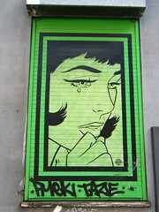 Manchester, Northern quarter street art. (rossendale2016) Tags: building mounted wall poster woman lady upsetting coloured tinged tinge upset unhappy crying sad tears green iconic clever art street quarter northern manchester